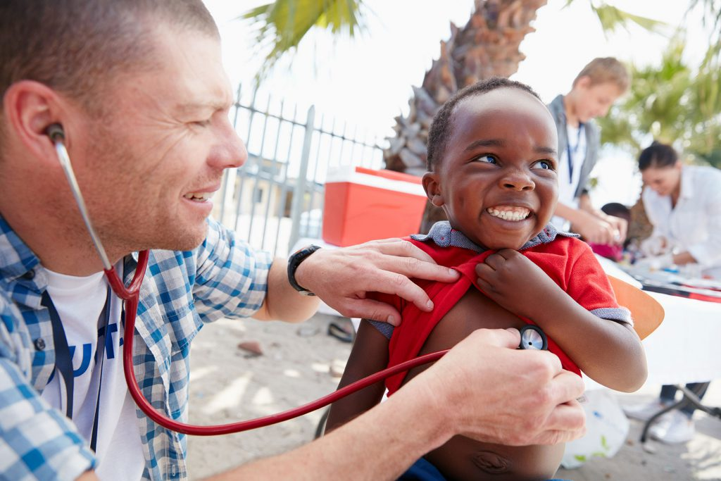 a non-profit organization doctor checking on little boy